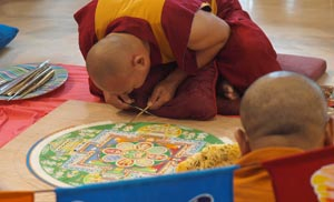 Buddhist monks create a sand mandala at the Mariposa.